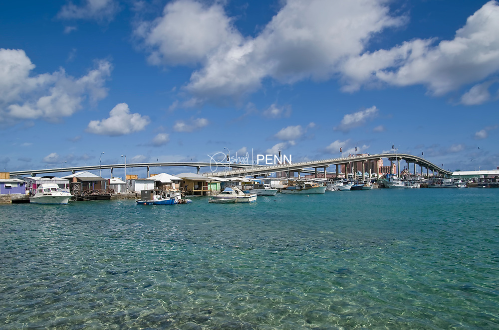 Potters Cay Dock boats and bahamians at work. Paradise Island bridges.