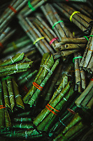 Natural cigarettes rolled in banana leaves at the Tropical Spice Plantation in Goa, India.