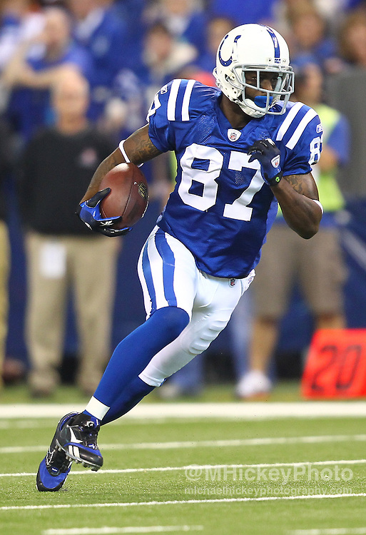 Sept. 18, 2011; Indianapolis, IN, USA; Indianapolis Colts wide receiver Reggie Wayne (87) runs the ball after a reception against the Cleveland Browns at Lucas Oil Stadium.  Mandatory credit: Michael Hickey-US PRESSWIRE