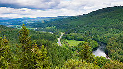 View of the Tay Valley at Strath Tay the A9 and River Tay from Pine Cone View point in Inver Wood near Dunkeld in Perthshire, Scotland, UK