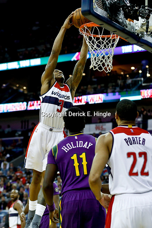 Jan 29, 2017; New Orleans, LA, USA; Washington Wizards guard Bradley Beal (3) dunks over New Orleans Pelicans guard Jrue Holiday (11) during the first quarter of a game at the Smoothie King Center. Mandatory Credit: Derick E. Hingle-USA TODAY Sports