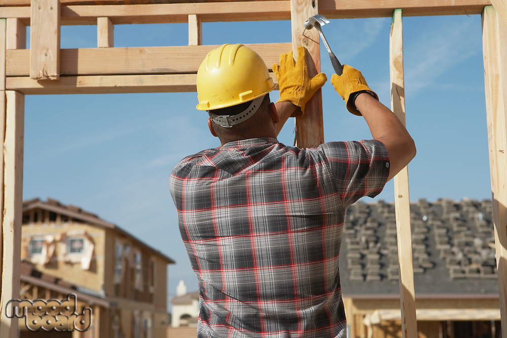 Construction Worker Working on Timber Frame
