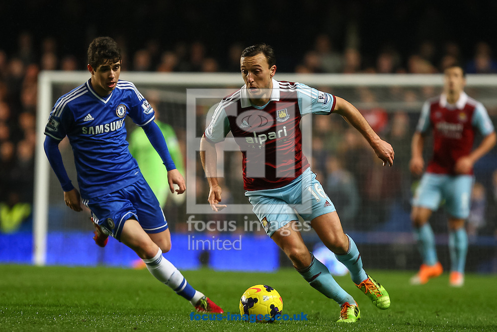 Picture by Daniel Chesterton/Focus Images Ltd +44 7966 018899<br /> 29/01/2014<br /> Mark Noble of West Ham United and Oscar of Chelsea compete for the ball during the Barclays Premier League match at Stamford Bridge, London.