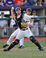 MANHATTAN, KS - APRIL 22:  Catcher Rob Vaughn (C) of the Kansas State Wildcats throws to first base in the fourth inning to get the runner of the UC Irvine Anteaters on April 22, 2008 at Tointon Stadium in Manhattan, Kansas.  UC Irvine defeated Kansas State 4-3.  (Photo by Peter Aiken/Getty Images)
