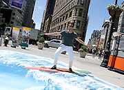 Nate Burkus rides a wave during #VisitAnaheim in 3D event in the Flatiron District in New York City, New York on June 24, 2015.