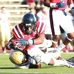 Samford wide receiver Riley Hawkins is tackled by Wofford CJ Turner at Seibert Stadium in Homewood, Ala., Saturday, Oct 13, 2012. Samford defeats Wofford 24-17 in Overtime. (Marvin Gentry)