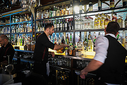 Staff working behind the bar at Brasserie Blanc in Covent Garden, London.