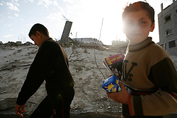Boys walk past a destroyed home in Jabaliya town in the Gaza Strip.