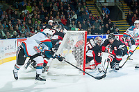 KELOWNA, CANADA - DECEMBER 30: Tyson Baillie #24 of Kelowna Rockets attempts a wrap around goal on the net of Ty Edmonds #35 of Prince George Cougars as Sam Ruopp #2 of Prince George Cougars tries to block the shot on December 30, 2014 at Prospera Place in Kelowna, British Columbia, Canada.  (Photo by Marissa Baecker/Shoot the Breeze)  *** Local Caption *** Sam Ruopp; Ty Edmonds; Tyson Baillie;