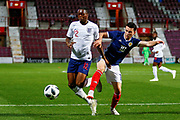 Aaron Wan-Bissaka England U21s (Crystal Palace) avoides the challenge of Lewis Morgan Scotland U21s (Celtic FC) during the U21 UEFA EUROPEAN CHAMPIONSHIPS match Scotland vs England at Tynecastle Stadium, Edinburgh, Scotland, Tuesday 16 October 2018.