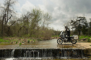 Bill Dragoo crossing a low water bridge across a stream in north central Arkansas.