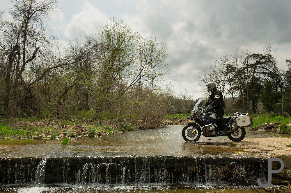 Bill Dragoo crossing a low water bridge across a stream in north central Arkansas.