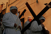 "Calitri (AV) Italy - 14/04/2006 -  In Calitri, the most important celebration of Good Friday is organized by the Fraternity of the Immaculate Conception. ``The Procession of the Mystery'' is a colourful and moving ritual in which fraternity brothers or ""fratelli"" don in white capes and hoods and wear crowns of thorns on their heads. They walk sombrely to the Sanctuary of Santa Lucia in the nearby Mount Calvery, followed by the town faithful."