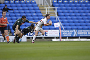 Reading, GREAT BRITAIN, Saracens Glenn JACKSON turn's as barry EVERITT put's in the flying tackle,  during the EDF Energy Cup, rugby match, London Irish vs Saracens at the Madejski  Stadium, ENGLAND, 30/09/2006. [Photo, Peter Spurrier/Intersport-images]..