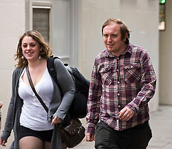 © licensed to London News Pictures.  02/08/2011. London, UK. Jonathan May-Bowles (right), AKA Jonnie Marbles arriving at Westminster magistrates court today (02/08/2011) where he is due to be sentenced  for assault and causing harassment, alarm or distress. May-Bowles threw a foam pie at Rupert Murdoch as he gave evidence over the phone-hacking scandal at the House of Commons Culture, Media and Sport Committee hearing. Photo credit: Ben Cawthra.