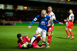 STEVENAGE, ENGLAND - Saturday, January 25, 2014: Everton's Steven Naismith in action against Stevenage's goalkeeper Chris Day during the FA Cup 4th Round match at Broadhall Way. (Pic by Tom Hevezi/Propaganda)
