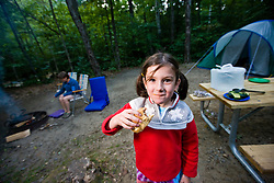 A young camper enjoys a hot dog  in Crawford Notch State Park in New Hampshire's White Mountains.