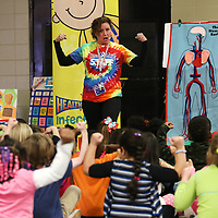 Adam Robison   BUY AT PHOTOS.DJOURNAL.COM<br /> Healthworks High-Flying Kid Motivator, Kim Burleson, gets Thomas Street Elementary School kindergarteners to flex their muscles to promote healty heart and lungs Tuesday morning in Tupelo.