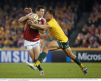 29 June 2013; Jonathan Sexton, British & Irish Lions. is tackled by Israel Folau, Australia. British & Irish Lions Tour 2013, 2nd Test, Australia v British & Irish Lions. Ethiad Stadium, Docklands, Melbourne, Australia. Picture credit: Stephen McCarthy / SPORTSFILE