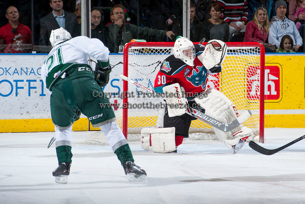 KELOWNA, CANADA - DECEMBER 6: Jordon Cooke #30 of the Kelowna Rockets makes a save on a shot from Joshua Winquist #21 of the Everett Silvertips on December 6, 2013 at Prospera Place in Kelowna, British Columbia, Canada.   (Photo by Marissa Baecker/Shoot the Breeze)  ***  Local Caption  ***