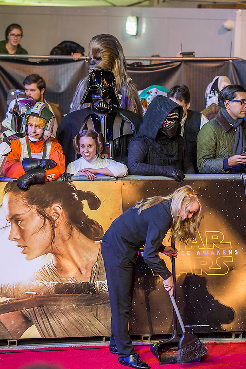 Re-enactors initially parade through and are then penned but nothing stops Preparations fo the red carpet - The European Premiere of STAR WARS: THE FORCE AWAKENS - Odeon, Empire and Vue Cinemas, Leicester Square, London.