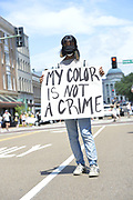 "6/6/2020 Jackson MS. <br /> Protestors of all ages and races gathered out side the Governor Mansion after a peaceful protest by Black Lives Matter, organized by 18yr old student Maisie Brown. AS the crowd chanted ""I can't breathe "" as the crown chanted _check his pulse.""  "" I can't breathe"" and "" justice for George Floyd, in addition to "" no justice No Peace in the 90 degree heat. Photo© Suzi Altman<br /> <br /> Student Maisie Brown 18yrs old from Jackson organized a peaceful protest outside the Governors Mansion. She said there voices would be heard and her face would be seen- change is coming. The protest was in honor of George Floyd and in support of ending systematic racism and to end police brutality in Mississippi and America. The National Black Panthers Party from Tupelo Mississippi showed up outside the Governors mansion in the shadow of the State Capitol to protest police brutality. The National Black Panthers Party was their to show their support for change in Mississippi, to end systemic racism and police brutality. Protests have broken out around the world in solidarity to end white supremacy and police brutality. The Panthers showed up at the end of a peaceful protest organized by 18yr old student Maisie Brown. The brutal murder of African American George Floyd by the knee and hands of 4 former Minneapolis Minnesota police officers has sparked a cry for justice and reform around the world. Photo copyright © Suzi Altman @suzialtman #mississippi #blm #blacklivesmatter #protest #icantbreathe #georgefloyd #endracism #policebrutality #documentary #history #suzialtman #iphonography #shotoniphone #zumapress #NBPP #panthers #blackpanthers #nationalblackpantherparty"