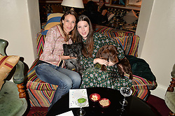 Left to right, CLAIRE FORLANI and her dog Ralph, LILY LEWIS and her dog Lullah at A Date With Your Dog At George in aid of the Dogs Trust held at George, 87-88 Mount Street, London on 9th September 2014.