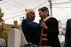 October 31, 2018 - Pittsburgh, PA, United States - An elderly man thanking a musician for his healing music. ..Outside the Tree of Life, many come to pay their respects whether it be rain or shine. Musicians from all around join to honor the victims and to facilitate healing. (Credit Image: © Esther Wayne/SOPA Images via ZUMA Wire)