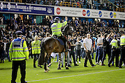 Police horses on the pitch after the Sky Bet League 1 play-off second leg match between Millwall and Bradford City at The Den, London, England on 20 May 2016. Photo by Nigel Cole.