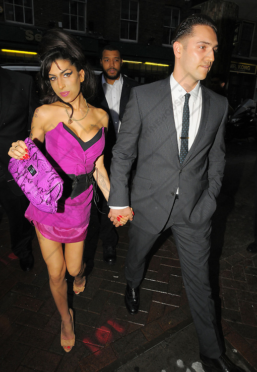 13.JULY.2010 - LONDON<br /> <br /> AMY WINEHOUSE AND BOYFRIEND REG TRAVISS ARRIVING AT THE PRINCE CHARLES CINEMA, LEICESTER SQUARE FOR THE PREMIERE OF REG'S NEW FILM PHYCHOSIS WHICH HE DIRECTED, THEY THEN HEADED ONTO THE AFTERPARTY AT THE BIRDCAGE CLUB, HAYMARKET WHERE THEY STAYED TILL 12.30AM AND BEFORE HEADING HOME.<br /> <br /> BYLINE: OPTICPHOTOS.COM<br /> <br /> *THIS IMAGE IS STRICTLY FOR UK MAGAZINES AND WORLDWIDE SALES ONLY*<br /> *FOR WEB USE PLEASE CONTACT OPTICPHOTOS - 0208 954 5968*