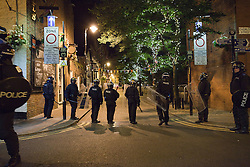 © Licensed to London News Pictures. 10/08/2011. Salford, UK. Police stand guard on Canal Street in Manchester's Gay Village, where windows were smashed. Scenes of desctruction in Manchester, where people rioted and looted and premesis were set alight. Photo credit : Joel Goodman/LNP