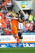 Dundee forward Sofien Moussa (#9) wins the aerial battle with Dundee United defender Mark?Durnan (#4) during the Betfred Scottish Cup group stage match between Dundee and Dundee United at Dens Park, Dundee, Scotland on 29 July 2017. Photo by Craig Doyle.