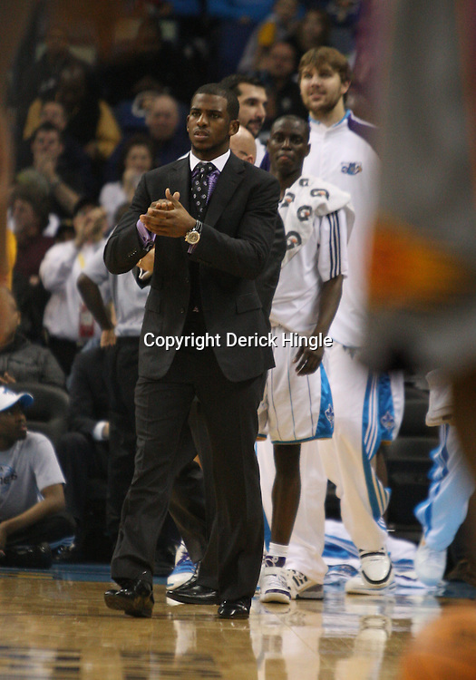 Feb 01, 2010; New Orleans, LA, USA; New Orleans Hornets guard Chris Paul out with a knee injury greet his team during a time out in the first half against the Phoenix Suns at the New Orleans Arena. Mandatory Credit: Derick E. Hingle-US PRESSWIRE