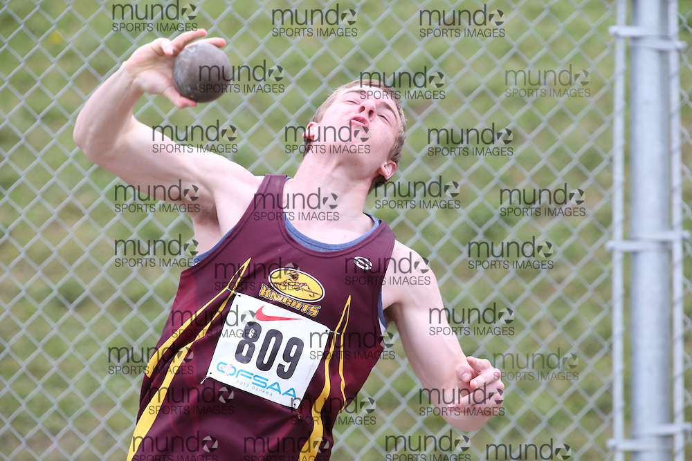 Dylan Gosselin-Archer of Geraldton Comp HS - Geraldton competes in the senior boys shot put at the 2013 OFSAA Track and Field Championship in Oshawa Ontario, Thursday,  June 6, 2013.<br /> Mundo Sport Images / Sean Burges