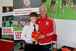 NEWPORT, WALES - Sunday, May 28, 2017: Iwan Murray receives a cap from Elite Performance Director Ian Rush for participation during day three of the Football Association of Wales' National Coaches Conference 2017 at Dragon Park. (Pic by Mark Roberts/Propaganda)