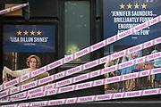 "The UK government has announced a Coronavirus pandemic financial rescue package for the Arts industry, a £1.15bn support for cultural organisations in England which is made up of £880m in grants and £270m of repayable loans. But venues such as the Duke of York's Theatre in the West End whose last production was 'Blithe Spirit', will remain closed for the foreseeable future, on 7th July 2020, in London, England. Some theatres in London and others around the country have been wrapped in bright pink barrier tape, which reads ""Missing Live Theatre"" -  a protest project led by stage designers group Scene Change. The arts and culture arts industry supports 137,250 jobs and is worth £21.2bn in direct turnover."