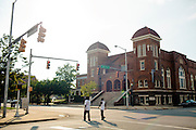 Men cross the street in front of 16th Street Baptist Church in downtown Birmingham, Alabama. In 1963, four girls were killed when a bomb under the church's side steps went off.