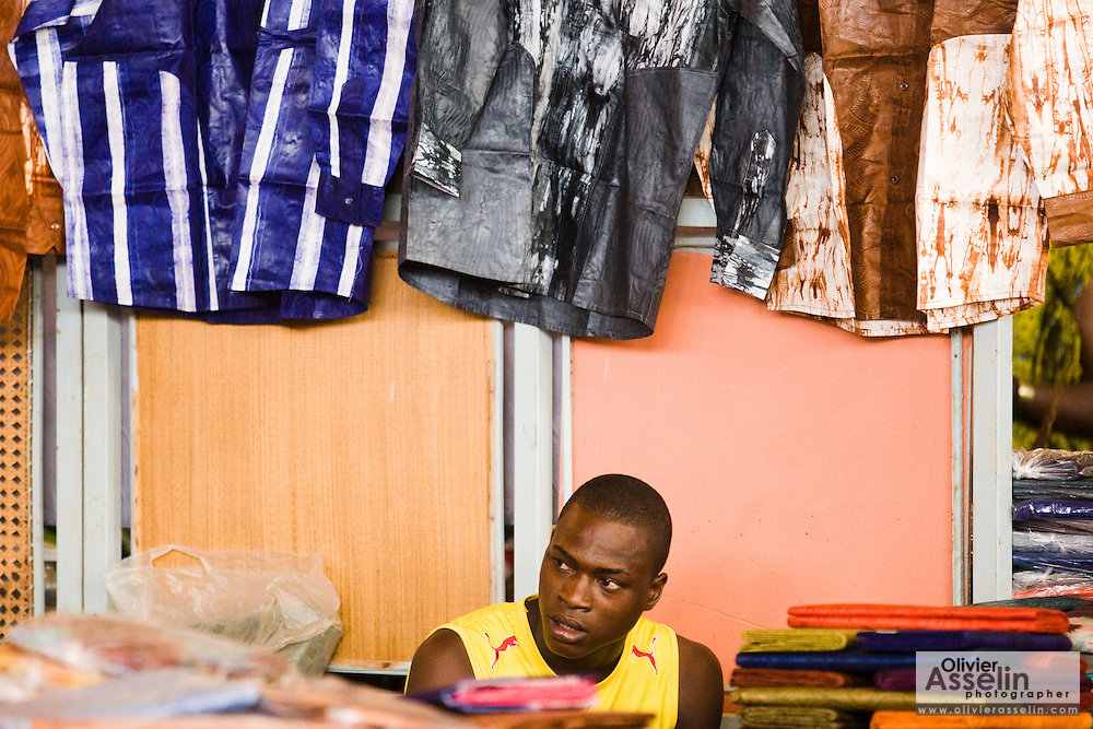 A vendor selling clothes and textiles at the 22nd Salon International de l'Artisanat de Ouagadougou (SIAO) in Ouagadougou, Burkina Faso on Sunday November 2, 2008.