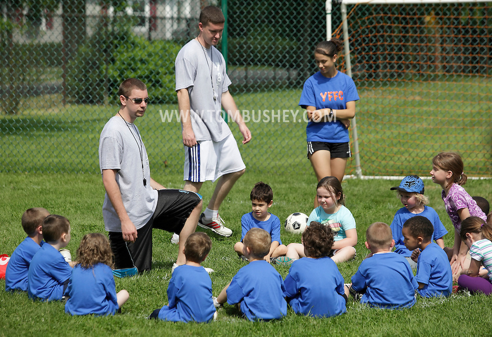 Middletown, New York - A coach talks to children at the end of a youth soccer program at the Middletown YMCA on May 28, 2011.