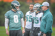 Philadelphia Eagles' former offensive coordinator, Pat Shurmur talks to punter Donnie Jones during Shurmur's first practice as interim head coach after the firing of Chip Kelly on Wednesday 30 December 2015 at the Nova Care Center in Philadelphia, Pa. . Photograph  by Jim Graham