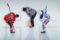 PENTICTON, CANADA - SEPTEMBER 8: Mark Jankowski #77 of Calgary Flames faces off against Austin Glover #67 of Edmonton Oilers on September 8, 2017 at the South Okanagan Event Centre in Penticton, British Columbia, Canada.  (Photo by Marissa Baecker/Shoot the Breeze)  *** Local Caption ***