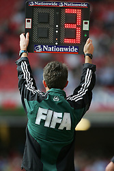 CARDIFF, WALES - SATURDAY MARCH 26th 2005: A FIFA official holds up an electronic board signalling three minutes injury time during the Wold Cup Qualifying match at the Millennium Stadium. (Pic by David Rawcliffe/Propaganda)