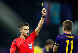 Referee Carlos Del Cerro (ESP) with yellow card for Luka Zahovic #11 of Maribor during First Leg football match between NK Maribor and FC Astana in Second qualifying round of UEFA Champions League, on July 14, 2015 in Stadium Ljudski vrt, Maribor, Slovenia. Photo by Vid Ponikvar / Sportida