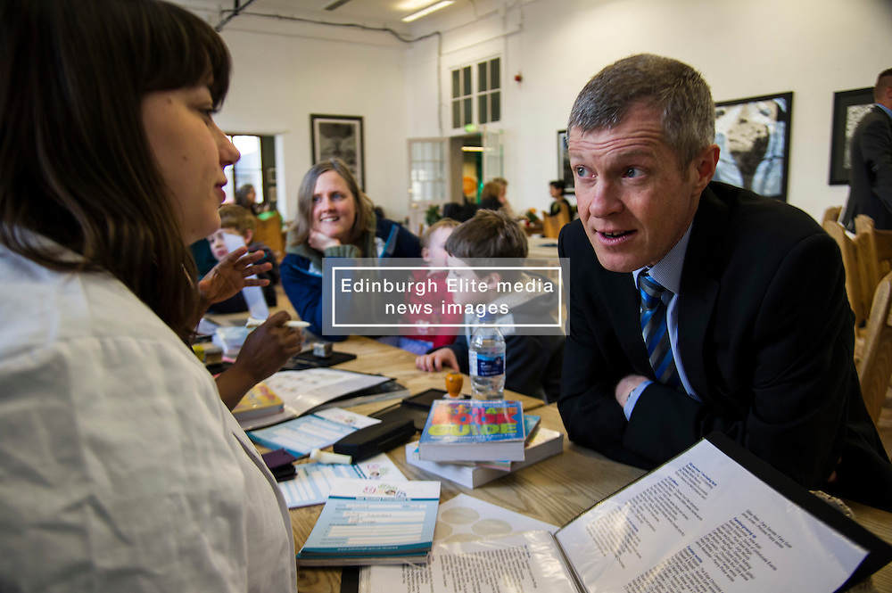 Pictured: Willie Rennie visited the surgery of Dr Book during his visit and picked up a reading prescription from Librarian Sarah Findlay<br /> <br /> Scottish Liberal Democrat leader Willie Rennie  set out plans for a digital revolution in the way that children learn at schools during a visit to the Edinburgh Science Festival at Summerhall, Edinburgh, today <br /> <br /> Ger Harley | EEm 6 April 2016