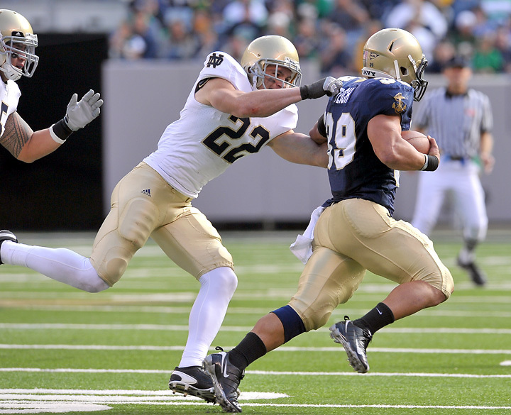 Safety Harrison Smith (22) gets his hands on Navy Midshipmen fullback Alexander Teich (39) in the third quarter.