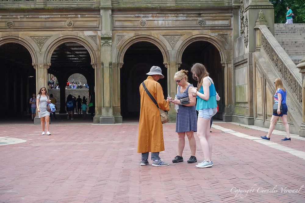 Fake monk  persuading tourists to give him money at Bethesda Terrace in Central Park