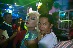 Drag queen and a bar guest.