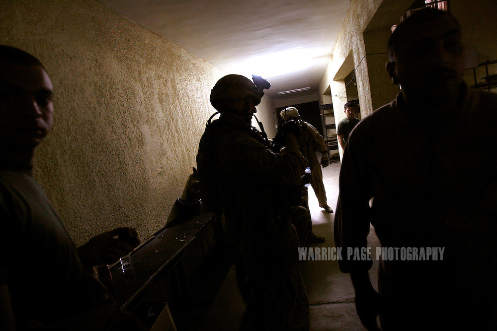 IRAQ, BASRA - JULY 4: US Marines of 1st Battalion 26th Brigade 2nd Division, prepare for an evening patrol in the poverty stricken neighborhood of Hayaniyah, July 4, 2008 in Basra, Iraq. When British forces withdrew in 2007, Basra deteriorated into street battles between numerous Shiite militias and criminal gangs. In April 2008, Iraqi prime minister, Nouri al Maliki, sent two Iraqi army divisions to retake control of Basra. While the fighting has ended, unemployment is rife, at about 70 per cent. Since early 2008, Iraq's security situation has improved with oil production increasing, record government surplus and easing sectarian tensions. (Photo by Warrick Page)