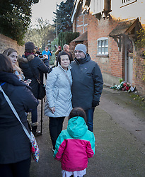 © Licensed to London News Pictures. 26/12/2016. Goring-, UK. Fans gather at the door of George Michael's house in Goring. Pop superstar George Michael died on Christmas day at his Oxfordshire home on the River Thames aged 53. Photo credit: Peter Macdiarmid/LNP