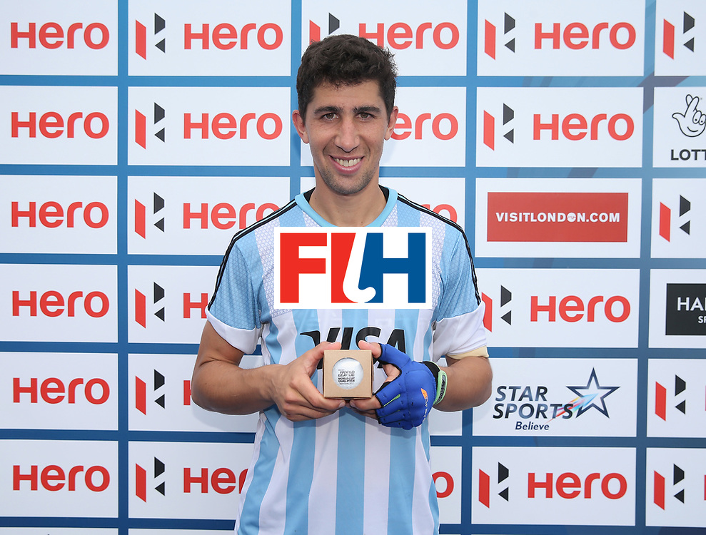 LONDON, ENGLAND - JUNE 24: Ignacio Ortiz of Argentina poses for a photograph with his milestone award after the semi-final match between Argentina and Malaysia on day eight of the Hero Hockey World League Semi-Final at Lee Valley Hockey and Tennis Centre on June 24, 2017 in London, England. (Photo by Alex Morton/Getty Images)